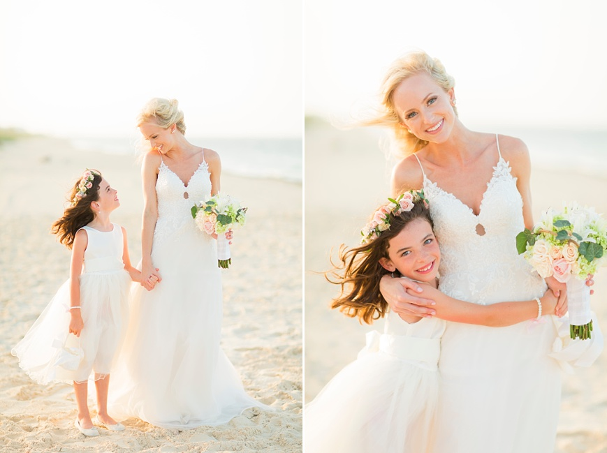 beautiful bride with flower girl on beach