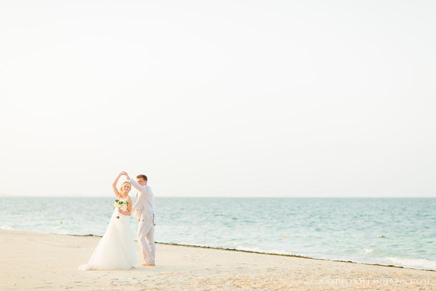 beautiful portrait of bride and groom dancing on beach