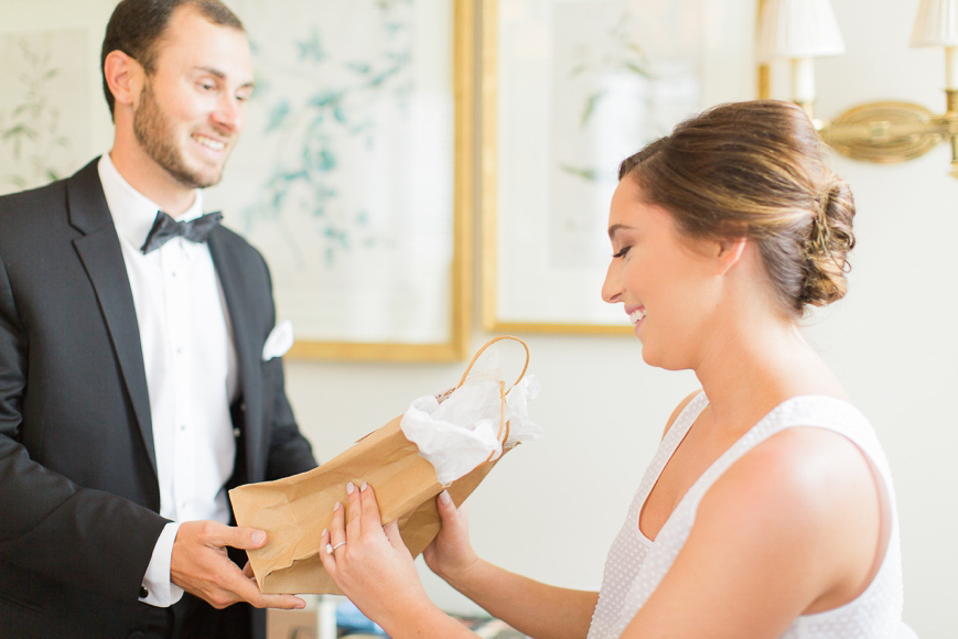 brother giving bride a gift from groom