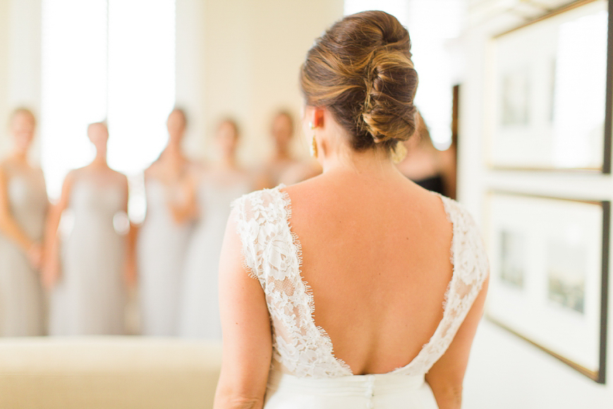 photo of bride looking at all of her bridesmaids
