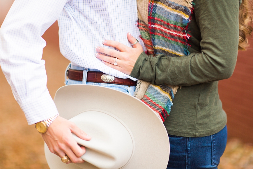 couple kissing cowboy hat