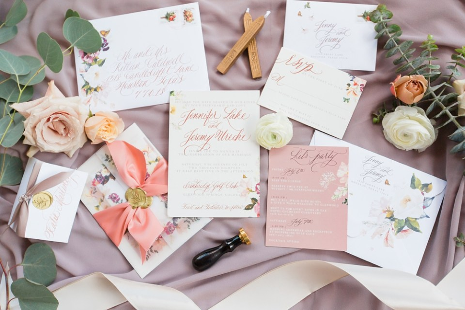 a fine flourish floral calligraphy wedding suite