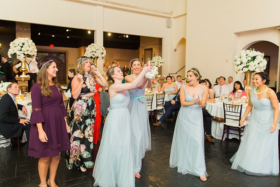 bridesmaids catching bouquet toss