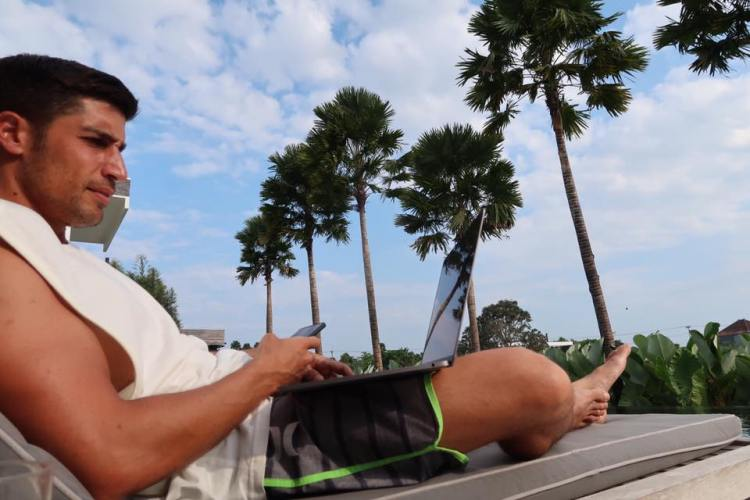 man relaxing while working