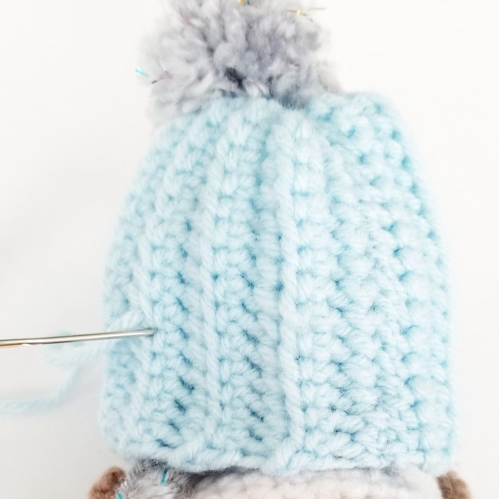 Sewing on hat