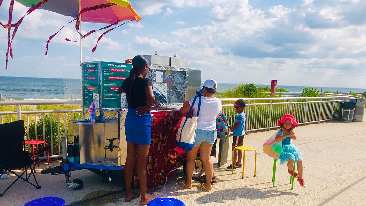 The Cradle NYC food cart on the Rockaway Beach boardwalk, summer 2019.