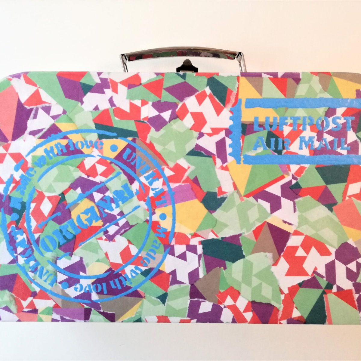 mini suitcase with decoupage decoration