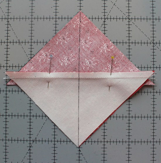 Quarter square triangle tutorial @ The Crafty Quilter.  Learn how to make perfect QST units every time and it includes an oversized cutting chart that you can download!
