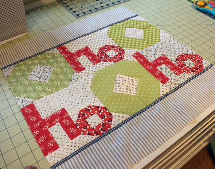 "Ho Ho Farmhouse Pillow Tutorial at The Crafty Quilter. 18"" square pillow is a perfect addition to your holiday decor."