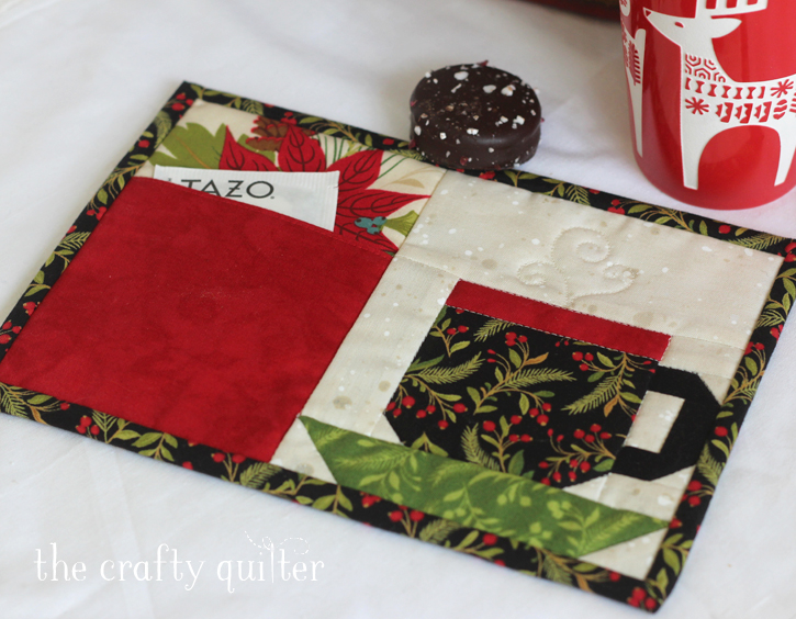 Christmas Pocket Mug Rug pattern from The Crafty Quilter