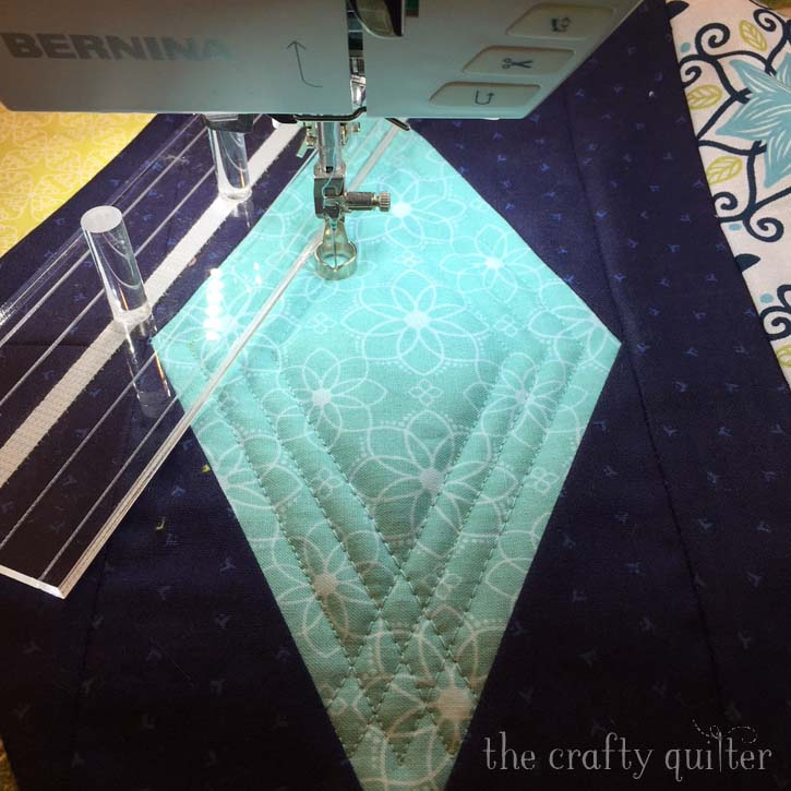 Sneak peak by Julie Cefalu @ The Crafty Quilter.  Featuring ruler work on a domestic machine.