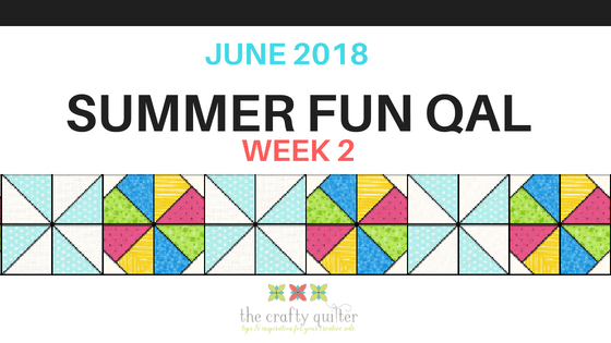 """Summer Fun Quilt Along @ The Crafty Quilter features a bright and happy wall hanging that measures 30"""" x 32"""". Week 2 instructions include the pinwheel blocks and beach ball blocks."""