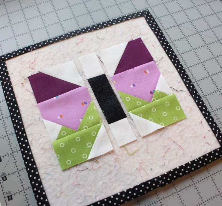 """The Summer Fun Quilt Along @ The Crafty Quilter creates a bright and happy wall hanging that measures 30"""" x 32"""". Week 4 instructions include the Sunny Star block and the Butterfly block."""