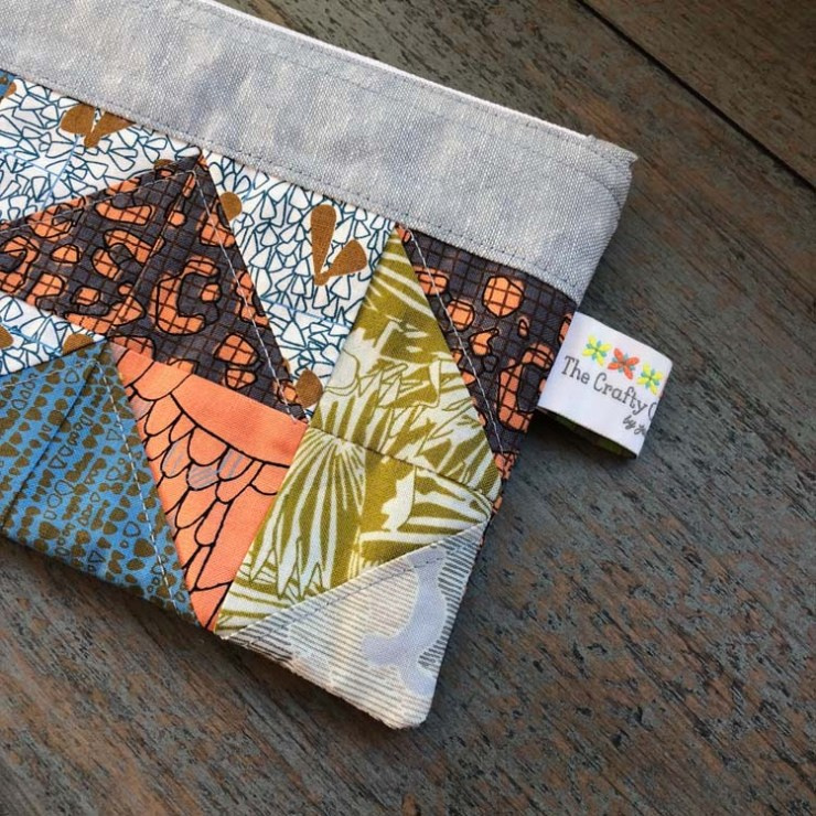 Two finished pouches made by Julie Cefalu @ The Crafty Quilter. Pattern and kit from Sew Lux Fabrics
