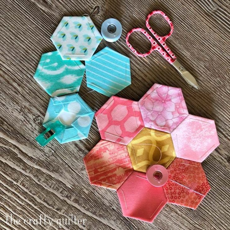 Quilt-y News for March 26, 2020 shared by Julie Cefalu @ The Crafty Quilter.  Paper pieced hexagons are an ongoing project!