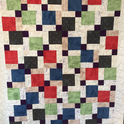Disappearing 9-patch quilt made by Sue R. via The Crafty Quilter.