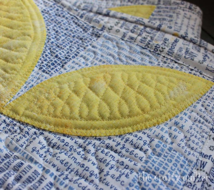Quilting detail of table runner by Julie Cefalu @ The Crafty Quilter.