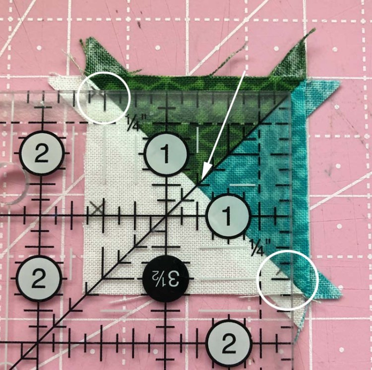Tips for Trimming a QST with a square ruler @ The Crafty Quilter.