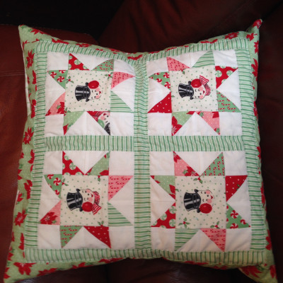 Christmas in July pillow made by Hannah W. from a kit by Sew Lux Fabrics.  Winner of the September UFO & WIP Challenge @ The Crafty Quilter