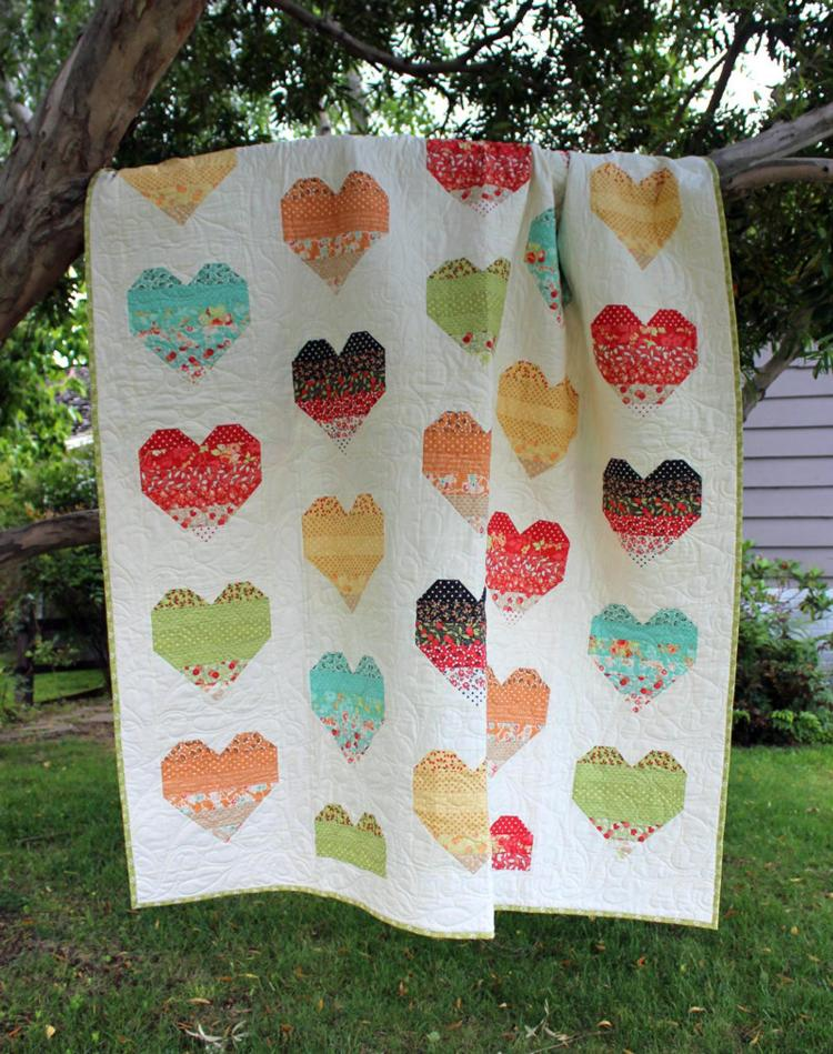 Ombre Love Quilt Pattern by The Crafty Quilter Designs is Layer Cake friendly and suitable for a confident beginner.