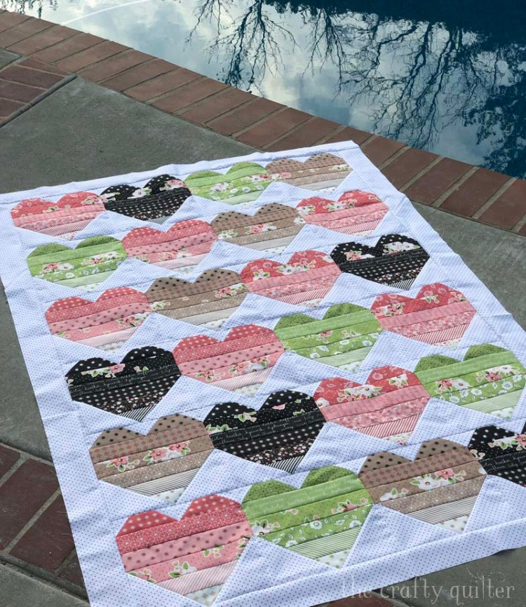 """Ombre Love quilt designed and made by Julie Cefalu @ The Crafty Quilter.  This version is without sashing and makes a 53"""" x 68"""" quilt."""