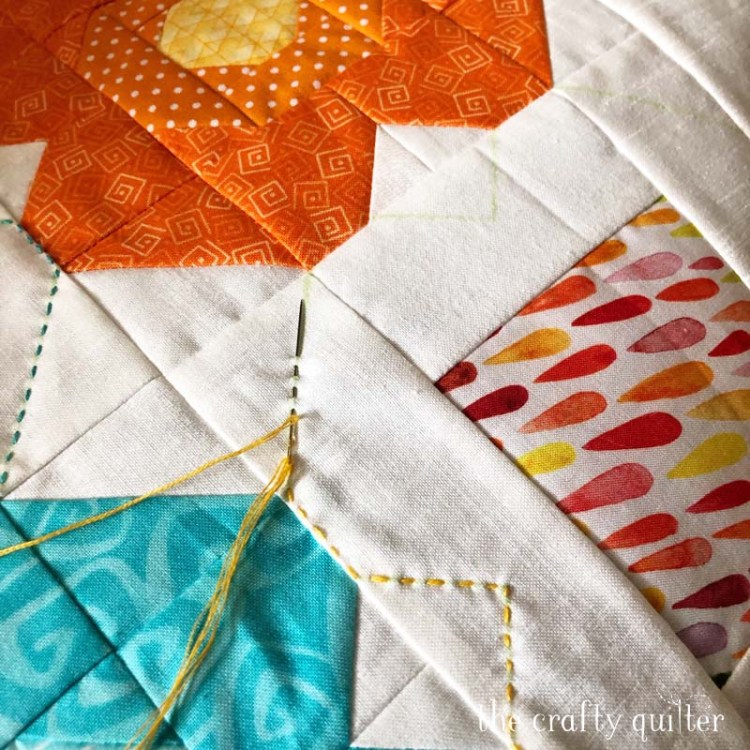 Blossom Pillow made and designed by Julie Cefalu @ The Crafty Quilter.  Free Blossom Quilt Block Tutorial is included.