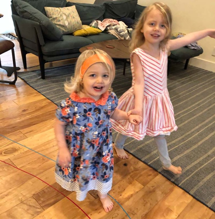 Clara and Amelia in their pretty dresses