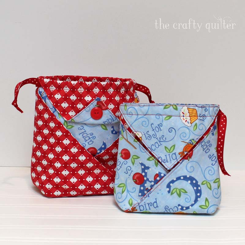 Fabric origami pouch tutorial @ The Crafty Quilter comes in three sizes.  Medium and large are pictured here.