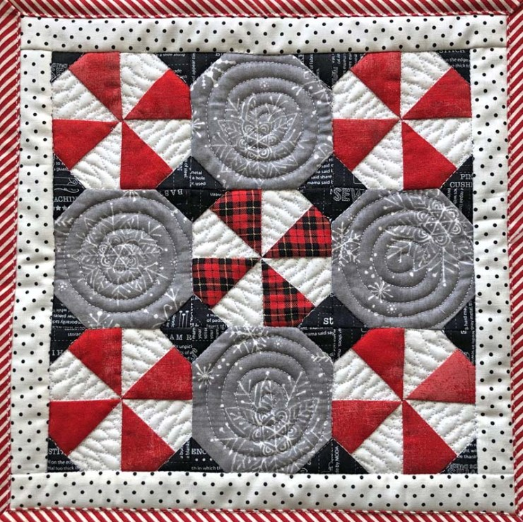 Peppermint Snowball Candy Mat - a free pattern from The Crafty Quilter.  Perfect to set underneath a bowl or plate of cookies and candy.