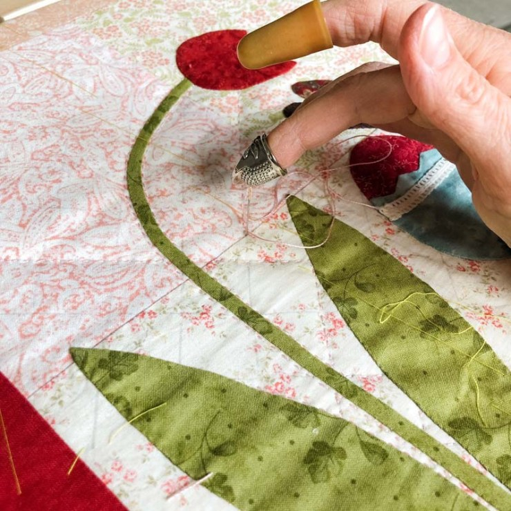 Hand quilting by Julie Cefalu @ The Crafty Quilter
