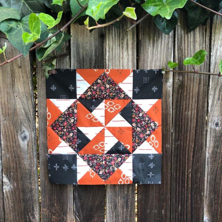 Block 10 of Red at Night BOM 2 using Kismet fabric.  Made by Julie Cefalu, pattern by Bound to be Quilting