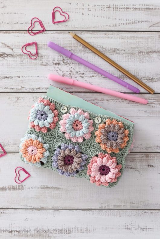 Crochet Flower Clutch Bag by Thoresby Cottage - part of a Spring Floral crochet pattern round-up by The Crafty Therapist
