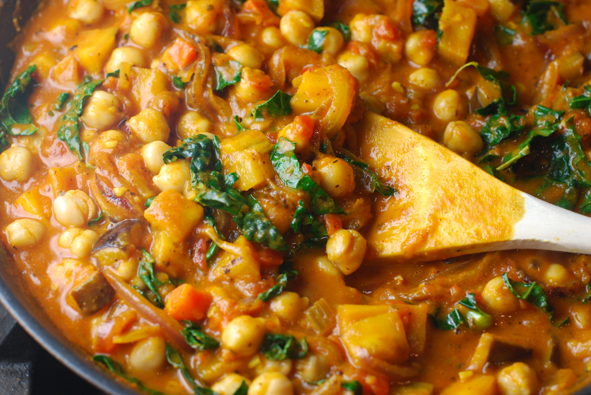 Chickpeas, eggplant and kale simmering in a curried tomato sauce.