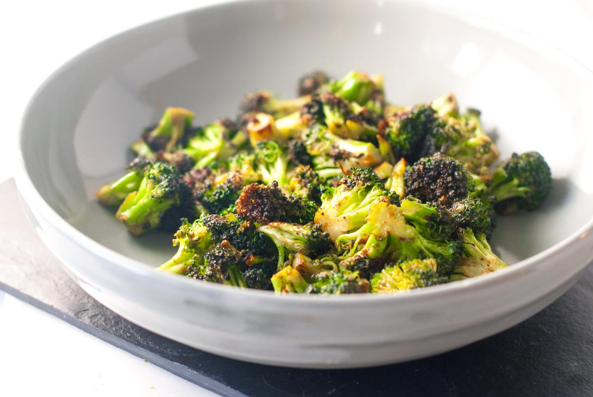 Bowl of charred broccoli.