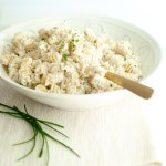 A bowl of corkscrew pasta tossed with creamy ricotta and fresh chives.
