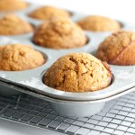 Sweet Potato Almond Butter Muffins pictured in the muffin tin after baking
