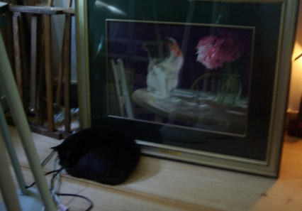 black cat near painting