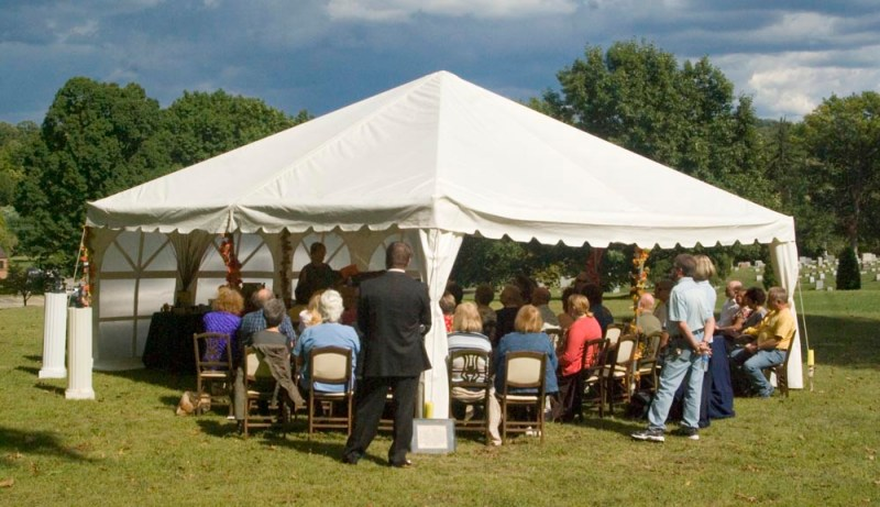 tent with people at pet memorial ceremony