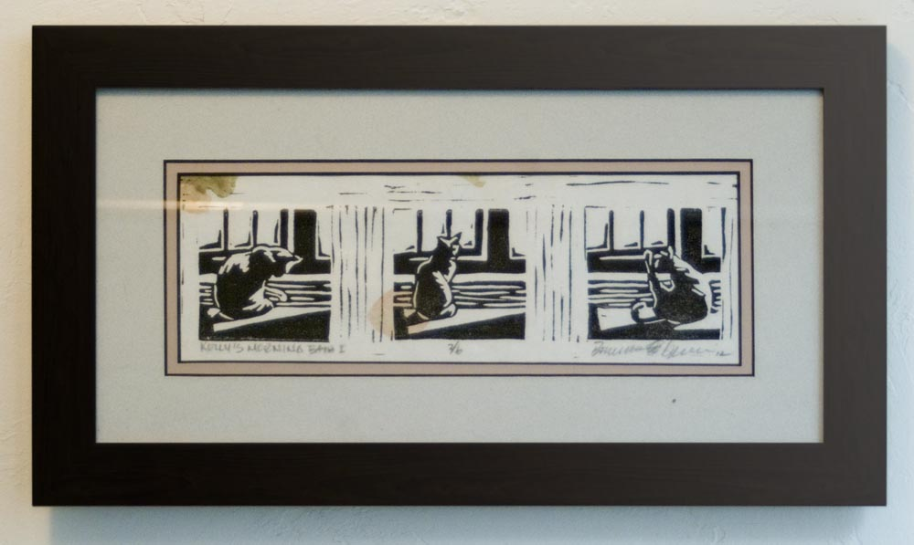 matted and framed block print of cat