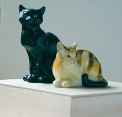 two steinlen cat figurines