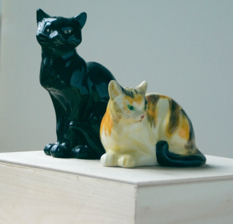 two steinlen cat figurines