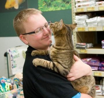boy holding tabby cat