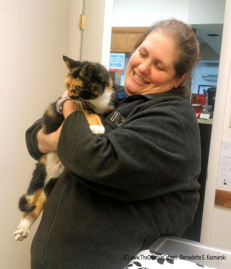 Dr. Mendenhall with the rescued calico.