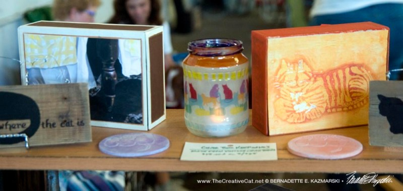 Keepsakes, votives and coasters on display.