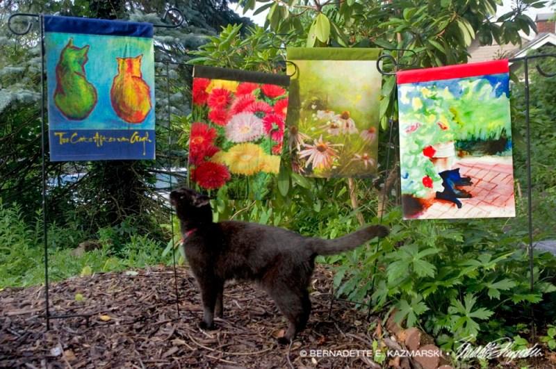 black cat with garden flags