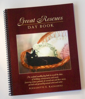 day book with cat portraits