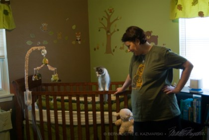 woman with cat in crib