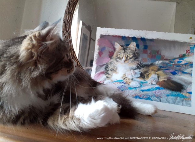 Mariposa looks at her painting