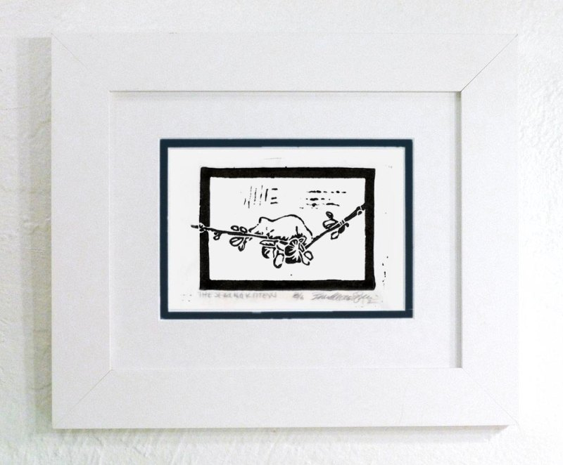 """""""Spring Kitten"""", no tinting, black frame."""