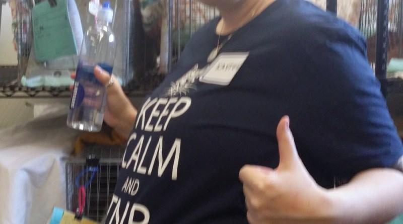 pregnant woman in TNR tee shirt